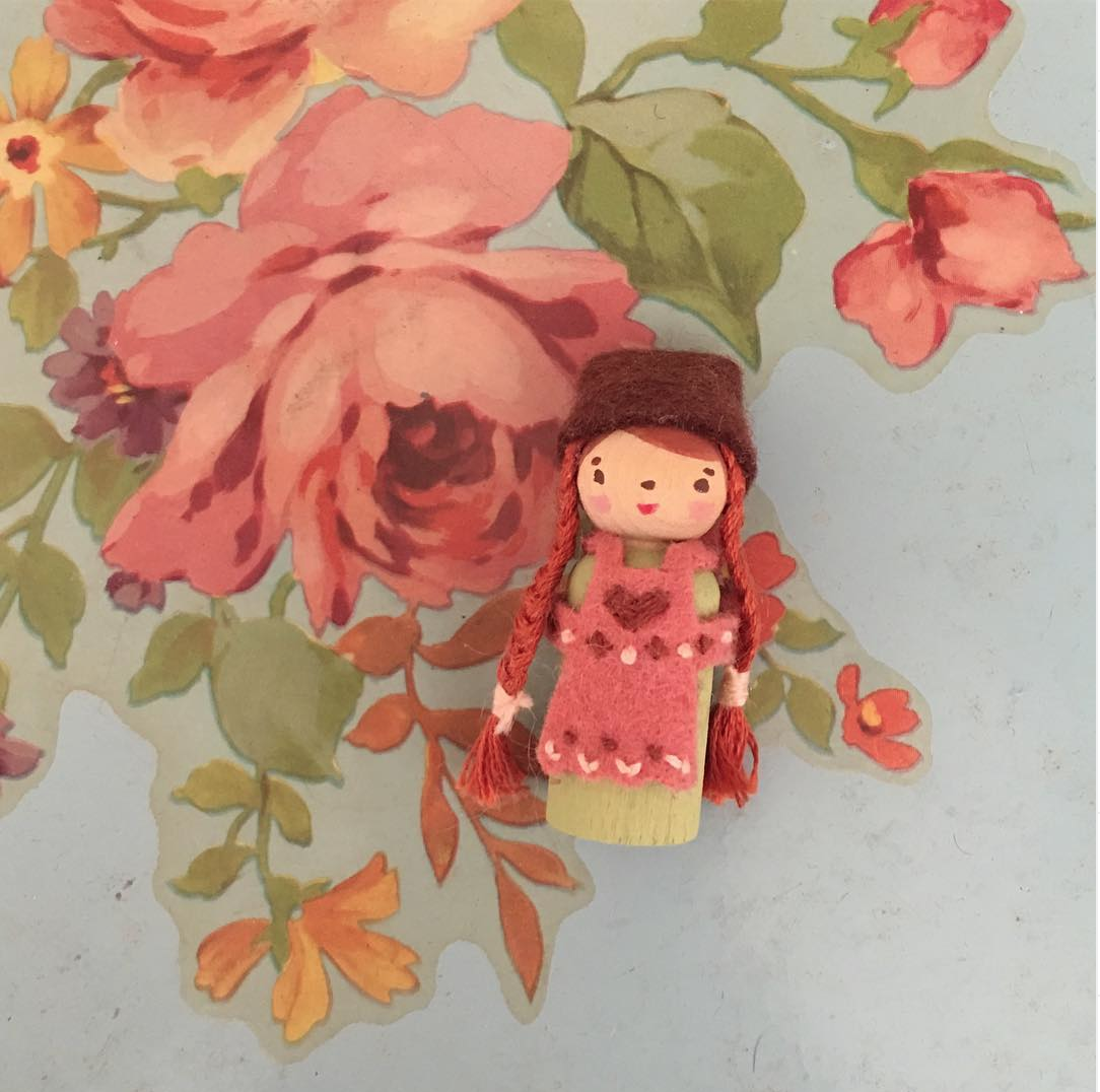folky painted wooden peg doll