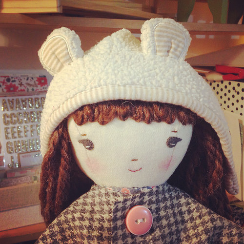 doll in teddy coat