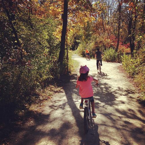 kids riding bikes in autumn