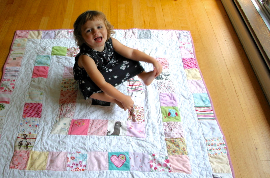quilt made from baby's clothes