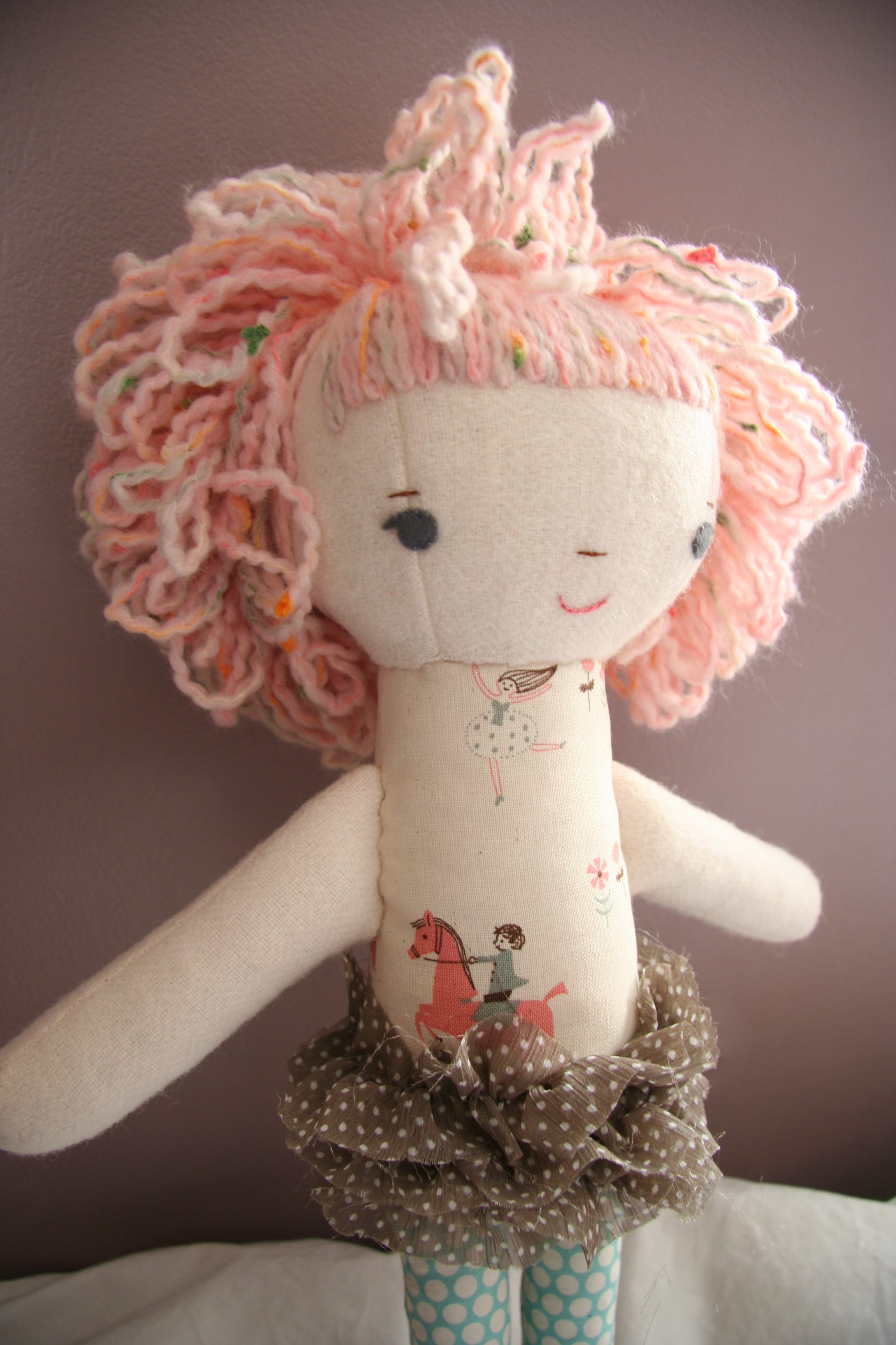 pink puffy curly haired doll