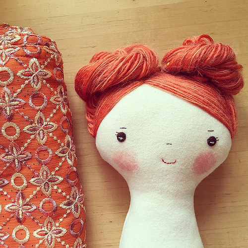 wool doll with yarn hair buns